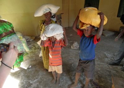 Children collecting food distributed